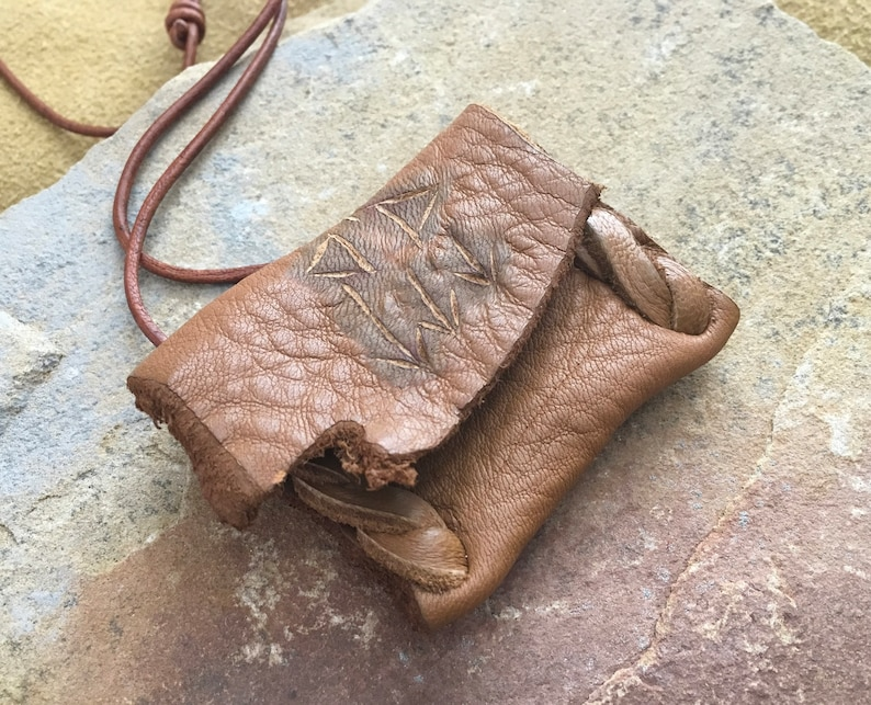 Communication...This Wisdom Pouch is made out of a warm toasty Brown Deerskin Leather and it features a hand carved symbol.
