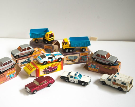 9 Lesney Die Cast Cars 1970s Some  Boxes Articulated Truck Pink Window Le Car Orange Windos Rallye Royale, Police Car and 2 more matchbox