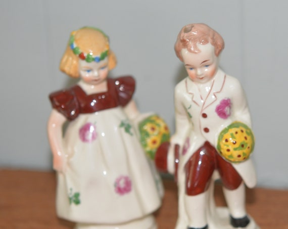 Czechoslovakia Pair Figurines  mark Girl with flower basket, boy with Top Hat 1930s Porcelain Children Figurines