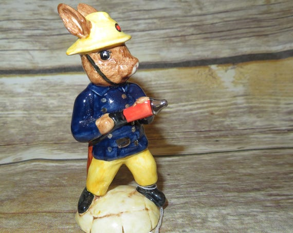 Royal Doulton 1988 Limited edition bunnykins Fireman, With Royal Blue coat and hose Bunny Free shipping