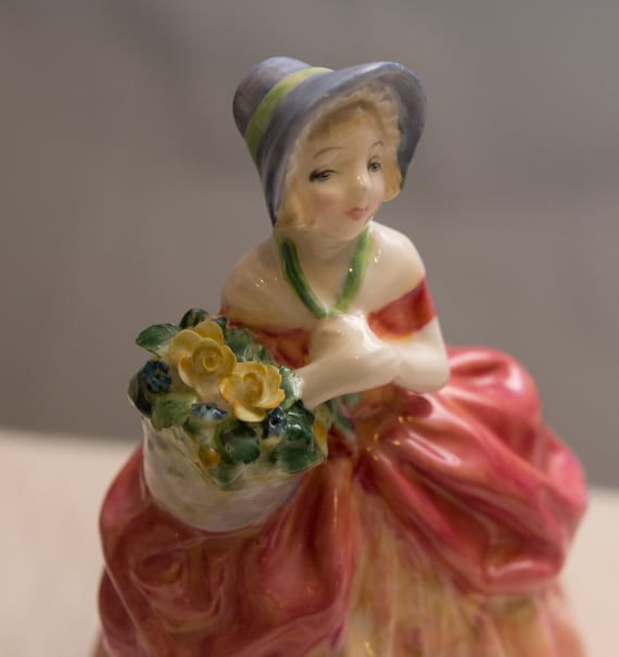 Royal Doulton Figurine Cissie HN1809 L.Harridine 1937-1993 Pink Dress yellow Flower basket