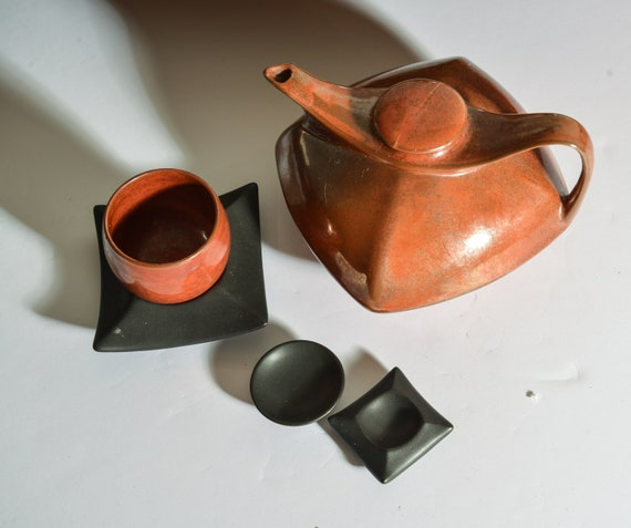 Japanese clay tea pot cup and accessories, luminescent finish, red brown with black accessories tea for 1