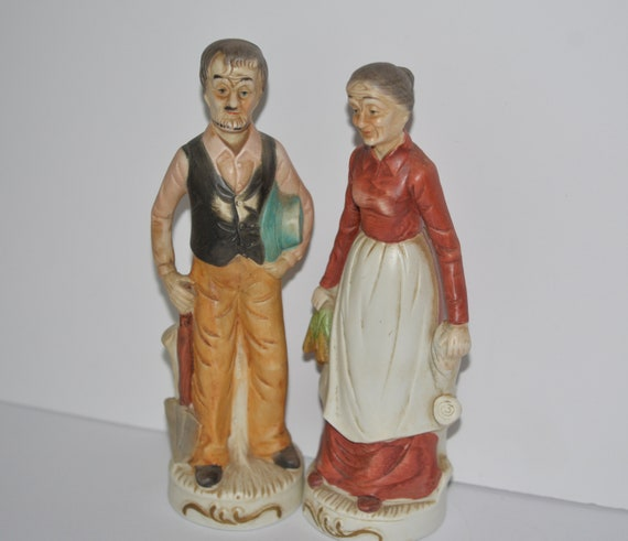 Vintage bisque porcelain Farmer Figurine Couple Old man and Old Lady with carrots and shovel