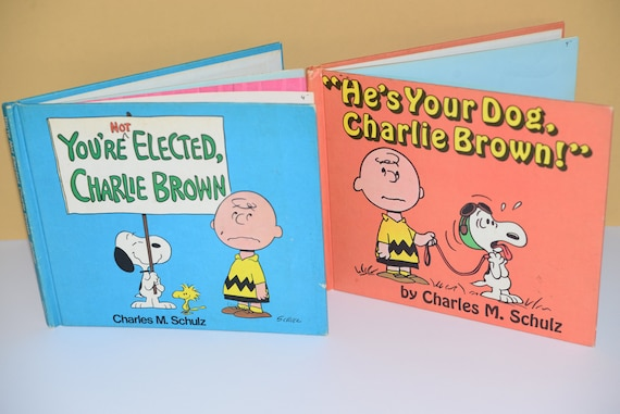 Two American Publishing 1973 and 1968 Charlie Brown Books He's your Dog Charlie Brown and You're Not elected Charlie Brown  Hard Backs