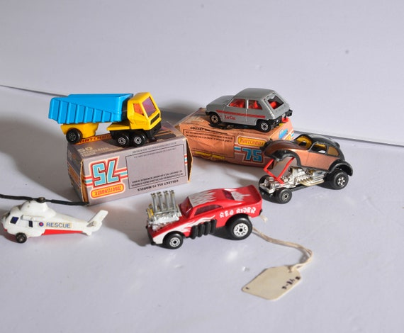 Lot of 5 Matchbox Lesney  VW Funny Car, Le Car, articulated truck Dumptruck, helicopter, red rider two with boxes Hot Chocolate VW