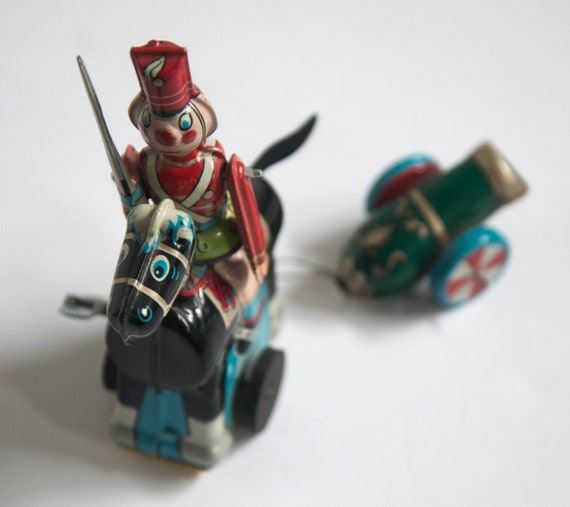TPS Japan Tin Toy Soldier Complete with Cannon riding Pony Wind up toy works Complete working Key wound lithograph toy