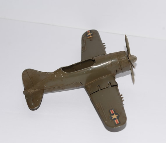 Hubley Folding Wing Kiddie Toys Die cast Plane Circa 1960s Army Green with decals F4U Corsair cica 1960s