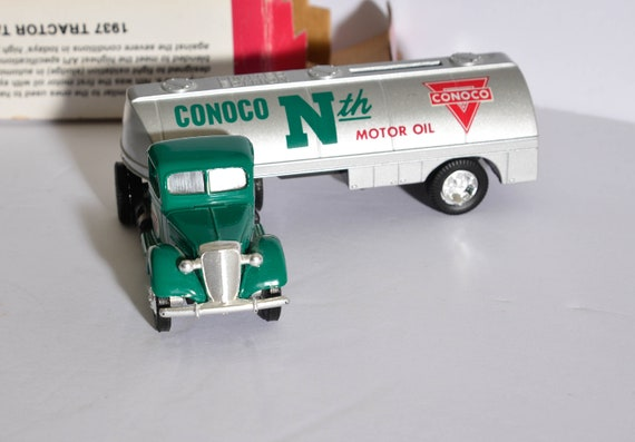 1937 Die cast Ertl Truck bank Conoco Oil Tanker Mint in box 1997 limited edition die cast toy.