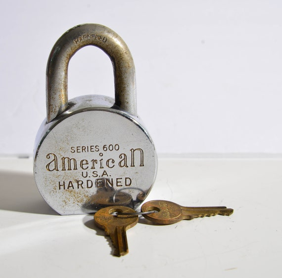 Vintage 1970s Heavy Stainless Steel Series 600 American Padlock with Key Super chunky and heavy works.