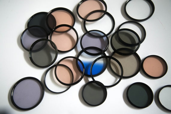 Lot of 20 Plus Tiffin Photography Filters 58mm to 82 mm Neutral Density , Gradient, UV and others with cases Misc Photography lens filters