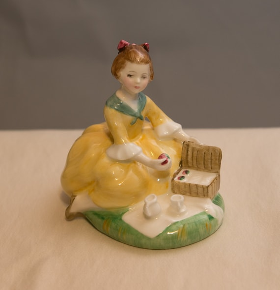 Royal Doulton Porcelain  Figurine in a yellow dress having a Picinic HN-2308 Designed by M. Davies 1965-1988