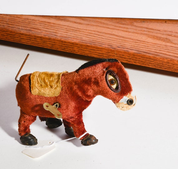 Vintage Wind Up toy Sad Donkey Made in Japan works but needs TLC 1940s Plush over Metal Clock Work Toy with Key