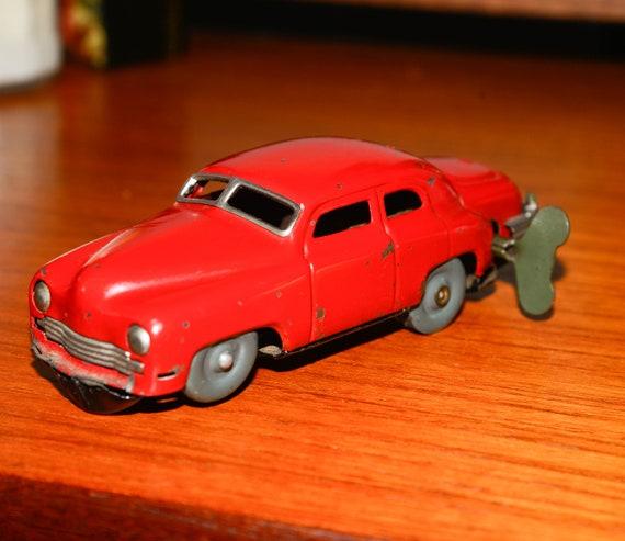 Occupied Japan Metal Wind up Magic Car Works 1940-50 Tin Car clock works Red Car