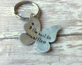 Semi colon keyring- suicide awareness, my story isn't over yet - The rest is unwritten By Inspired Jewelry Designs