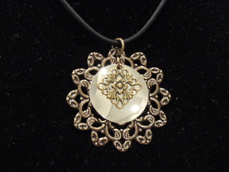 Surprise pendant in antique gold and shiny silver Style #1345B