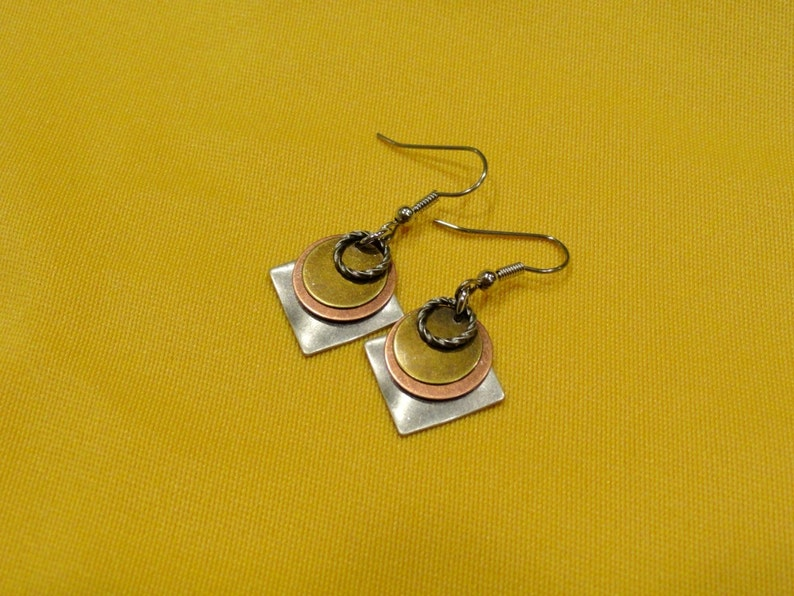 I want it all and I want it now multi color silver earrings image 0