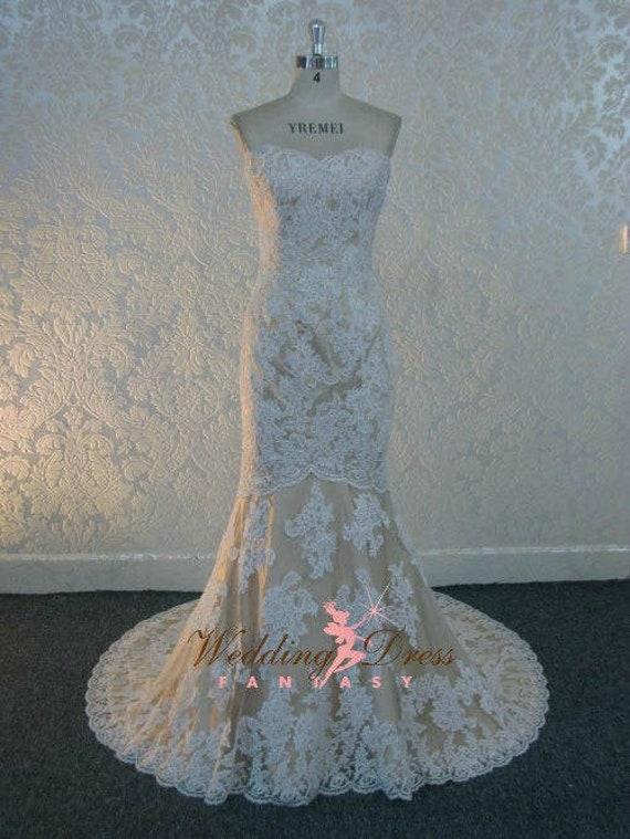Beautiful Ivory Lace Wedding Dress With Sweetheart Neckline Nude Beige Champagne Underlay By Award Winning Bridal Salon
