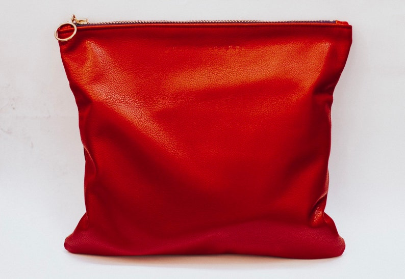 Maroon foldover leather bag image 0