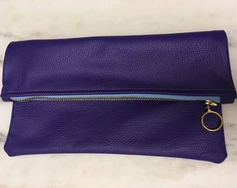 Purple leather clutch