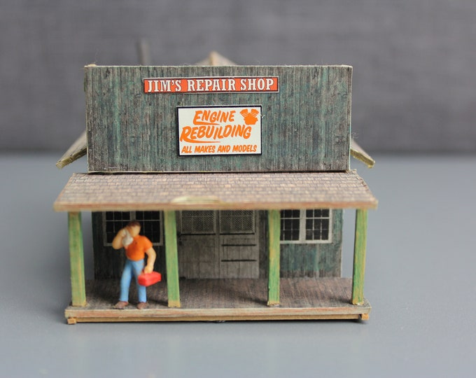 HO Scale Finished Model Jim's Repair Store Building with 1 figure for your Model Train Hobby