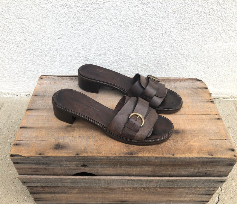 0bae35721a7a 1990 s Robert Clergerie Brown Leather Slides Mules Block