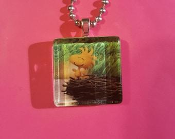 Woodstock Peanuts bird glass tile necklace