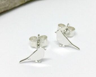 Bird silhouette sterling silver stud earrings.