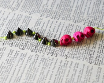 Edgy Bracelet with Pink Skulls, Gunmetal Spikes, and Neon Nylon String