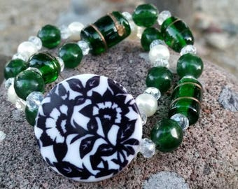 Green, Black, and White Beaded Stretch Bracelets with Large Floral Focal Bead - Set of 2 layering bracelets - Glass and Plastic Beads