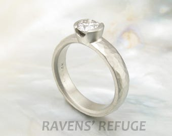 half bezel engagement ring with 3/4 carat diamond solitaire and 5mm wide hand-hammered white gold band