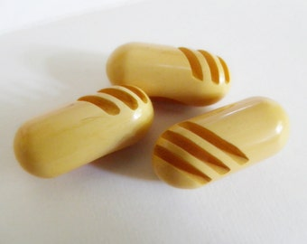 Creamed Corn Yellow Sliced Bakelite Toggle Buttons