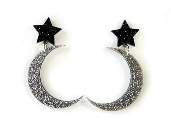 Star and Moon Dangle Earrings, Silver and Black Glitter Celestial Acrylic Jewelry, Laser Cut Space Drop Earrings, Outer Space Galaxy Plastic