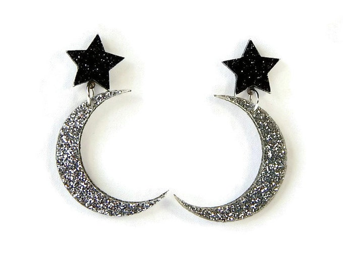 Featured listing image: Star and Moon Dangle Earrings, Silver and Black Glitter Celestial Acrylic Jewelry, Laser Cut Space Drop Earrings, Outer Space Galaxy Plastic