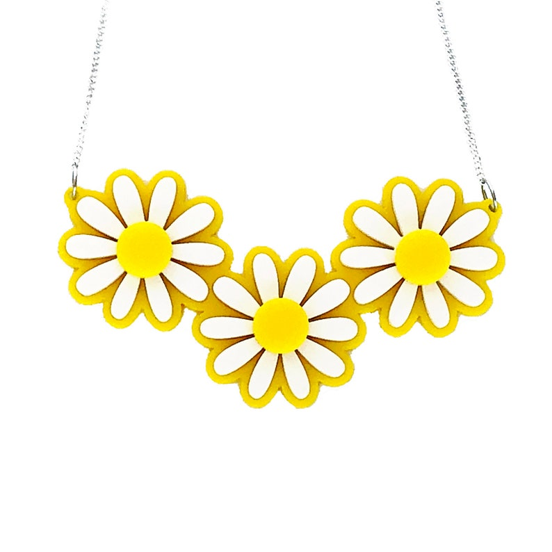 1960s Jewelry Styles and Trends to Wear Daisy Flower Statement Necklace Laser Cut Acrylic Floral Necklace Retro Rockabilly Pin Up Handmade Resin Jewelry $32.00 AT vintagedancer.com
