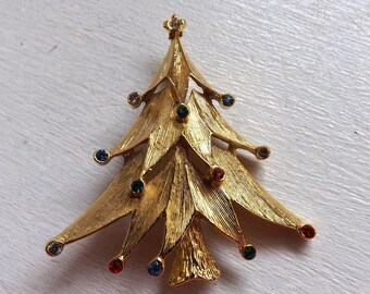 Vintage book piece JJ Jonette Jewelry Co. rhinestone Christmas tree brooch pin gold tone with red blue clear and green stones