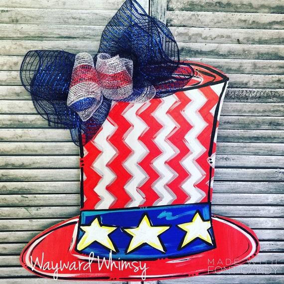 Patriotic bouquet in Uncle Sam hat wooden Door hanger