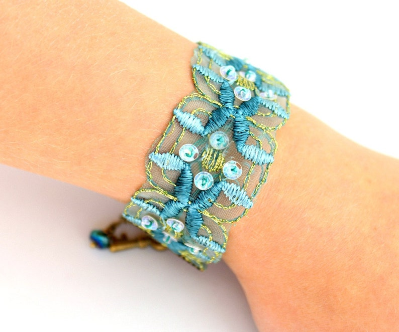 Blue Green Ribbon Bracelet with brass key and touches of image 0