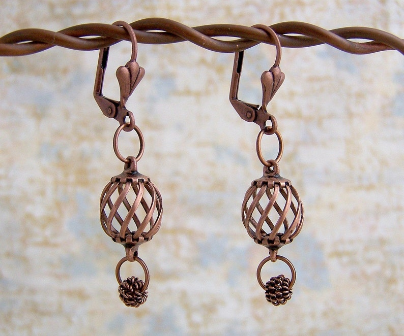 Antiqued Copper Earrings  spinning spirals and dangling wire image 0