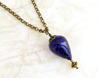 Blue hot air balloon necklace with a brass gondola below - hot air balloon jewelry - steampunk jewelry