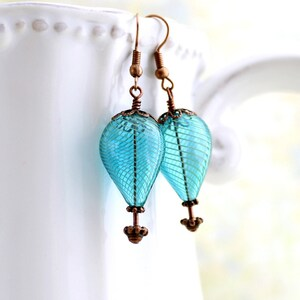 10 Electric Green Hot Air Balloon Earrings with a crystal cube as the basket.