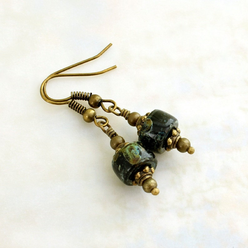 Earthy black and green earrings with antique brass findings  image 0