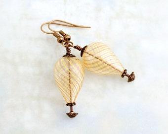 Peach hot air balloon earrings - yellow & peach stripe swirl around clear hand blown glass beads with copper findings