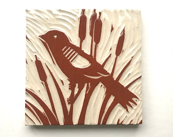 """Red Wing Blackbird in Cattails, 4"""" x 4"""" hand carved terra-cotta and white tile, linoleum block look"""