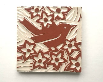 "Wren in flowers, 4"" x 4"" hand carved terra-cotta and white tile, linoleum block look"