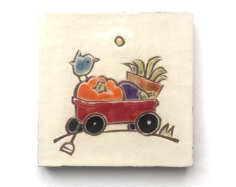 """4 inch tile, blue bird on a red wagon with garden harvest, 4"""" x 4"""" hand carved terra-cotta and white tile, trivet, or wall hanging"""