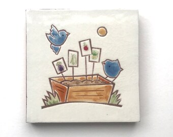 """4 inch tile, 2 blue birds on a wood planter box, 4"""" x 4"""" hand carved terra-cotta and white tile, trivet, or wall hanging"""