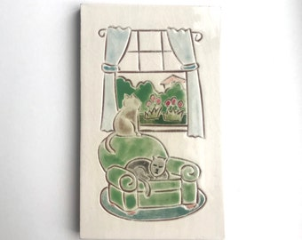 """5x8 inch tile, 2 gray cats on a green chair and window, 5"""" x 8"""" hand carved terra-cotta and white tile, trivet, or wall hanging"""