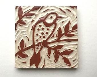 "Northern Flicker, 4"" x 4"" hand carved terra-cotta and white tile, linoleum block look"