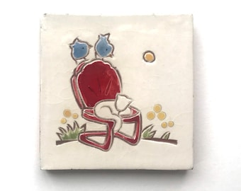 """4 inch tile, 2 blue birds on a red garden chair and white cat, 4"""" x 4"""" hand carved terra-cotta and white tile, trivet, or wall hanging"""