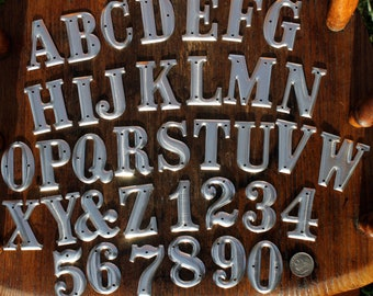 1.5 inch Metal Letters and Numbers- One and one half inch high aluminum letter/number listing for ONE letter/number NOT the entire alphabet.
